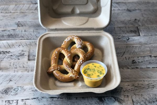 Land O'Lakes Foodservice Bacon Scallion Queso Dip with Pretzel in to-go container