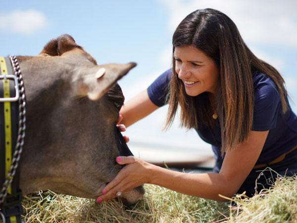 Woman farmer with female cow