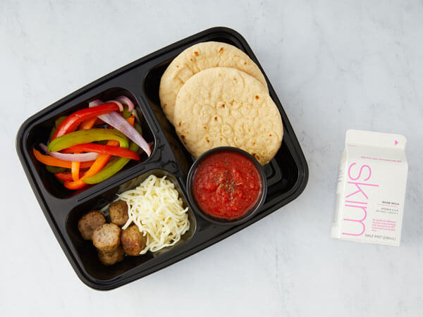 ALT TEXT: Land O'Lakes Foodservice | Mini Meatball Pizza Kit with mini turkey meatballs, mini flatbread rounds, marinara sauce dip cup, Land O Lakes® Shredded Mozzarella Cheese and bell pepper and onion blend