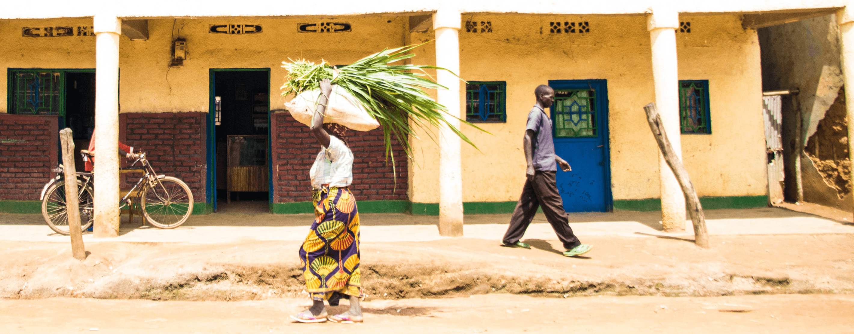 Cooperative Members Walking Down The Street In Rwanda