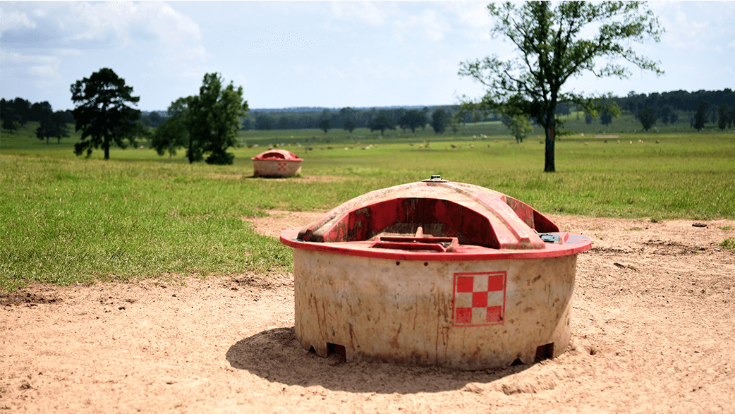 A Purina Feed Bin In A Field