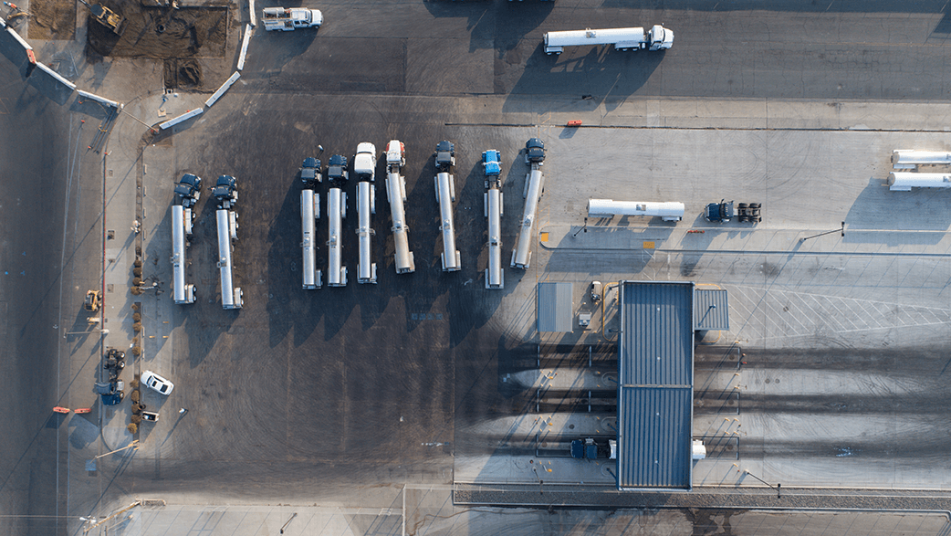 An Aerial View Of Milk Trucks