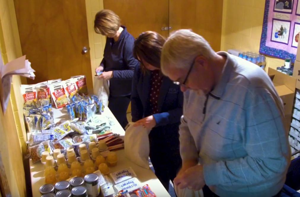 Volunteers Working At A Food Shelf