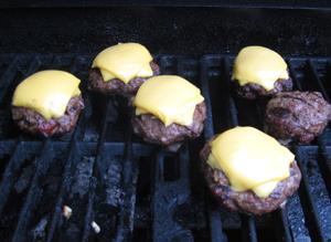 Mini burgers on grill