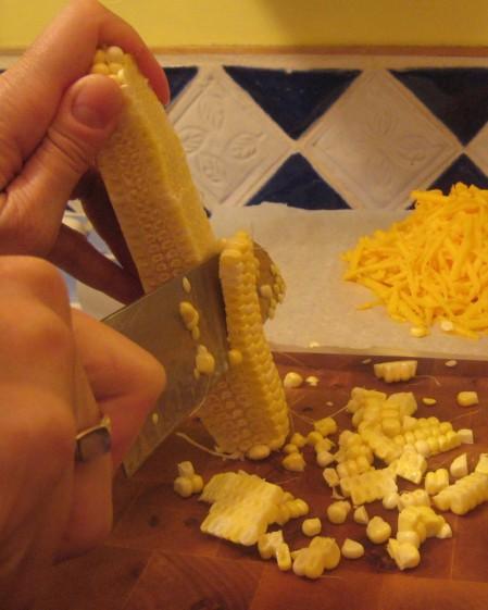 busy-corn-cutting-cropped-shot