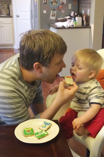 Dad and Son Eating Cookies