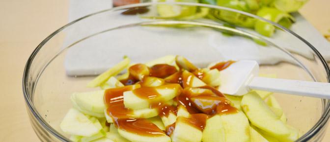 Toss Apples in Caramel Sauce