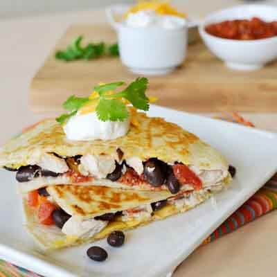 Cheese, bean and chicken quesadillas