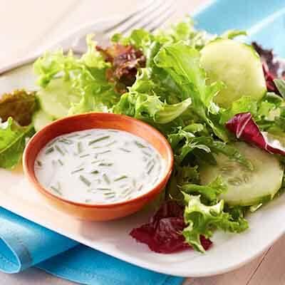 Creamy Dressing on Salad Greens Image