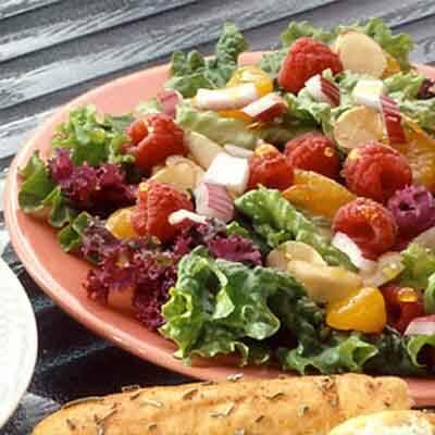 Mixed Green Salad With Orange Raspberry Dressing Image