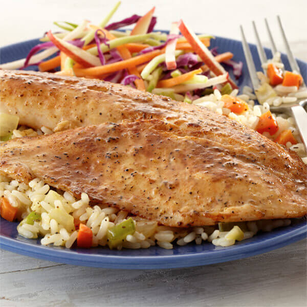 Lemon Paprika Tilapia over Rice Pilaf Image