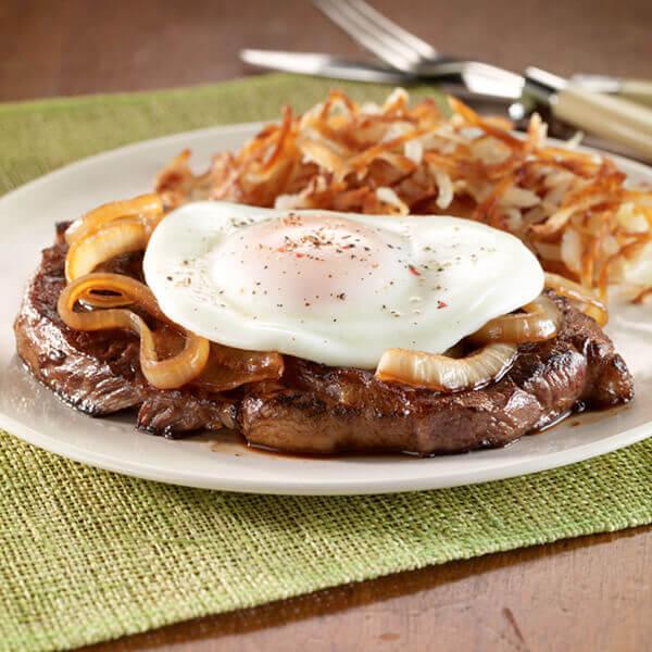 Rib Eye Steak With Caramelized Onion & Fried Egg Image