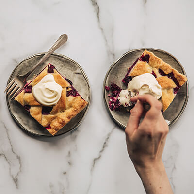Wild berry pie with forks